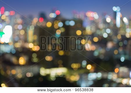 Abstract blurred bokeh of city business park light at night