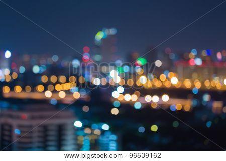 Bokeh light at night of office building skyline