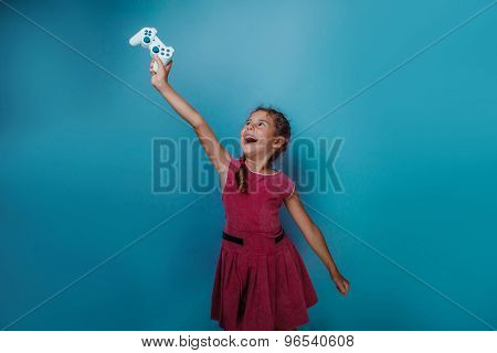 Girl European appearance ten years holding a joystick in his han
