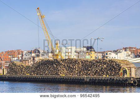Wood Logs And Crane In Port Of Kolobrzeg, Poland.