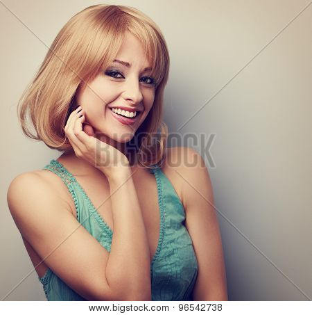 Happy Smiling Casual Blond Woman With Short Hair. Toned Closeup Portrait