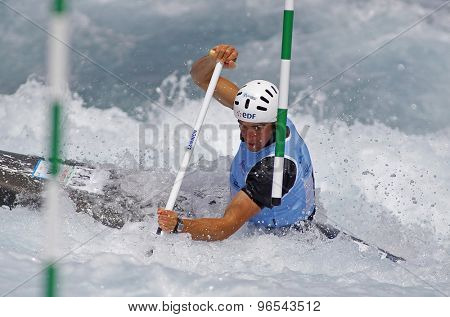 LONDON, ENGLAND - JUNE 06 2014 Jonathan Marc of France competes at the ICF Canoe Slalom held at the Lea Valley White Water centre Waltham Abbey.