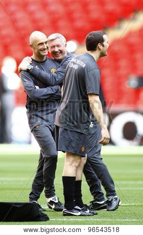 LONDON, ENGLAND. May 27 2011: Manchester's manager Sir Alex Ferguson laughing with the coaches during the official training session for the 2011UEFA Champions League fina