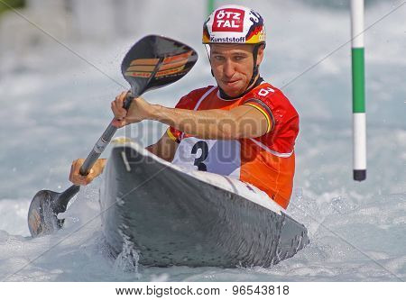 LONDON, ENGLAND - JUNE 06 2014 Fabian Doerfler of Germany competes at the ICF Canoe Slalom held at the Lea Valley White Water centre Waltham Abbey.