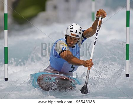 LONDON, ENGLAND - JUNE 06 2014 Matej Benus of Slovakia competes at the ICF Canoe Slalom held at the Lea Valley White Water centre Waltham Abbey.