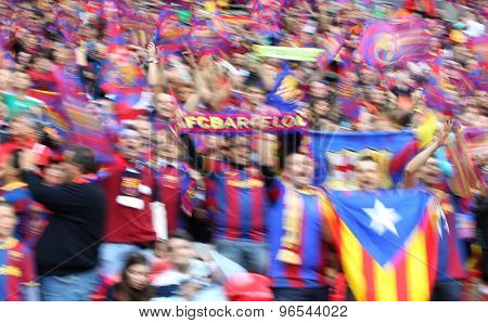 LONDON, ENGLAND. May 28 2011: A slow shutter shot of Barcelona fans during the 2011UEFA Champions League final between Manchester United and FC Barcelona, at Wembley Stadium