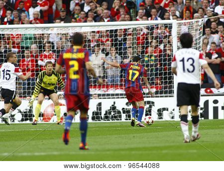 LONDON, ENGLAND. May 28 2011: Barcelona's midfielder Pedro Rodr�¢??guez scores  the first goal during the 2011UEFA Champions League final between Manchester United and FC Barcelona, at Wembley Stadium