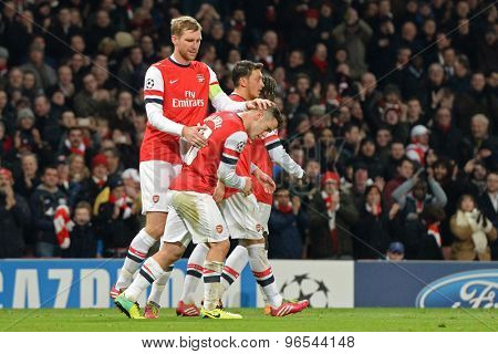 LONDON, ENGLAND - Nov 26 2013: Arsenal's Per Mertesacker congratulates Jack Wilshere after he scored the 2nd goal during the UEFA Champions League match between Arsenal and Olympique de Marseille