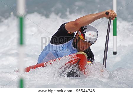 LONDON, ENGLAND - JUNE 06 2014 Jan Benzien of Germany competes at the ICF Canoe Slalom held at the Lea Valley White Water centre Waltham Abbey.