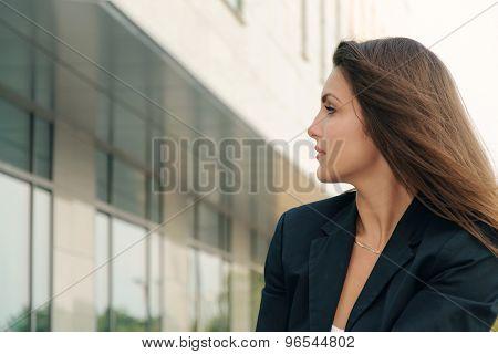 Portrait Of Business Woman In A Dark Suit