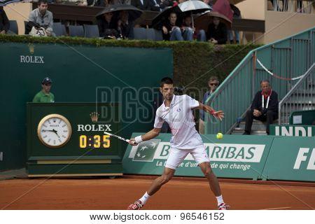MONTE CARLO, MONACO. APRIL 19 2012 Novak Djokovic (SRB) in action during the 3rd round singles match between Novak Djokovic (SRB) and Alexandr Dolgopolov (UKR) at the ATP Monte Carlo Masters  .
