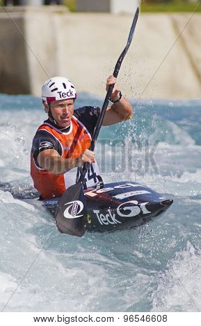 LONDON, ENGLAND - JUNE 06 2014 David Ford of Canada competes at the ICF Canoe Slalom held at the Lea Valley White Water centre Waltham Abbey.