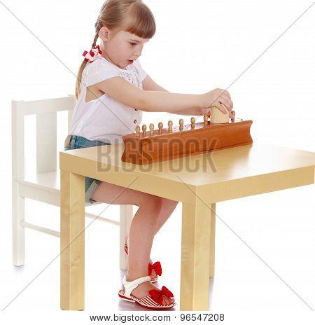 Girl exploring Montessori materials