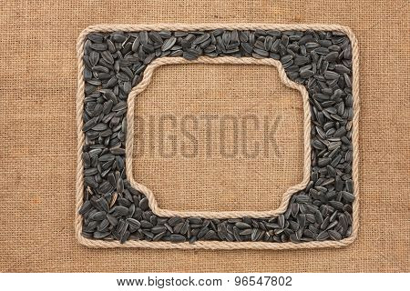 Two Frames Made Of Rope With Sunflower Seeds On Sackcloth