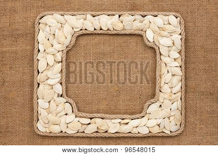 Two Frames Made Of Rope With Pumpkin Seeds On Sackcloth