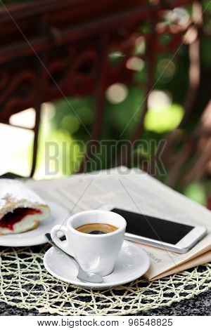 Cup of cappuccino on table in cafe