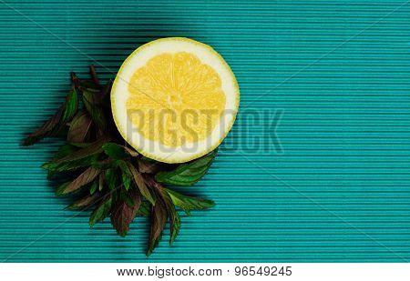 Lemon And Mint On Blue Background