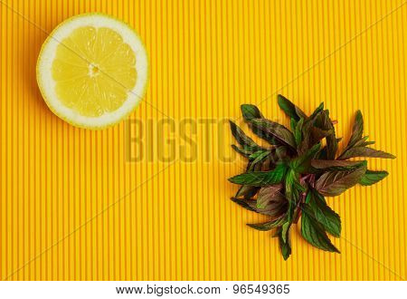 Lemon And Mint On Yellow Background