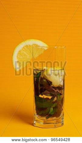Mojito Cocktail With Lemon And Mint On Yellow Background