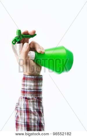 Hand Holding A Green Sprayer