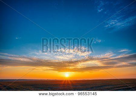 Field Meadow Road Under Sunset Sunbeams At Dawn Or Sunrise