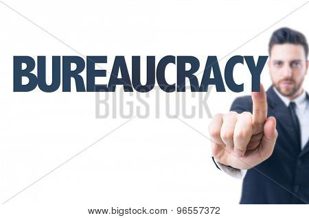Business man pointing the text: Bureaucracy