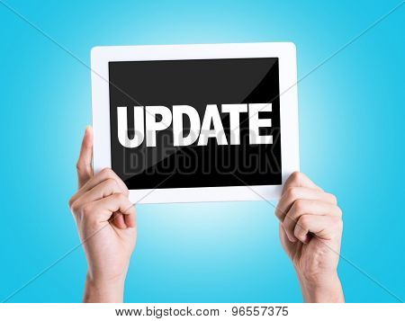 Tablet pc with text Update with blue background
