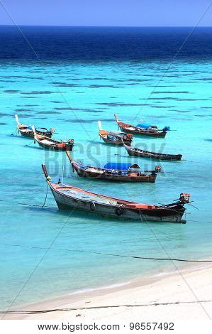 Fishing boats at Lipe island beach of the Andaman sea, in Satun Province of  Thailand