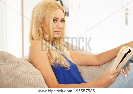 Beautiful woman reading on a sofa