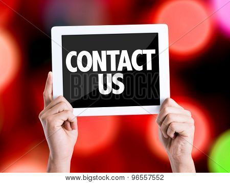 Tablet pc with text Contact Us with bokeh background