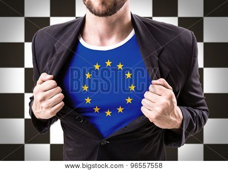 Businessman stretching suit with European Union with checkered flag on background