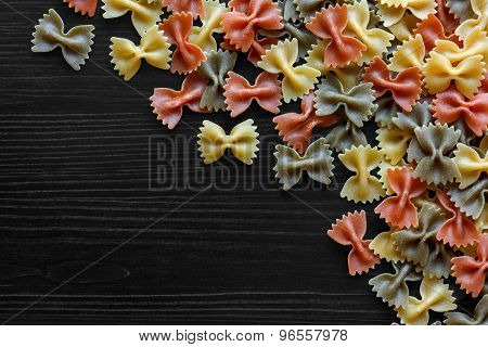 Dried pasta on black from above.