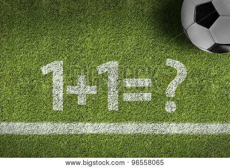 Soccer field with the text: 1+1=?