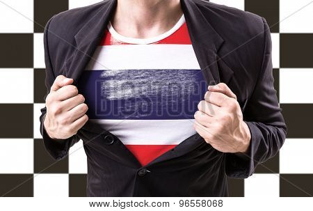 Businessman stretching suit with Thailand Flag with checkered flag on background