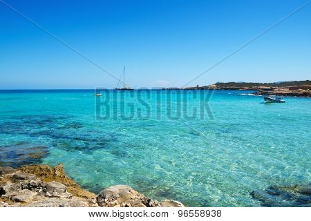 detail of the clear seawater at Cala Conta beach in San Antonio, Ibiza Island, Spain