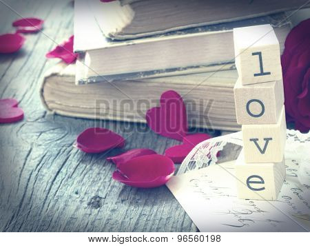 love letter with old books and red rose,vintage  concept of memory