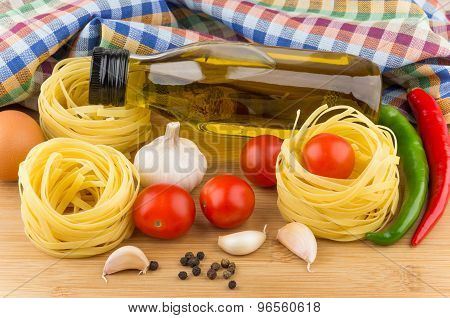 Tomatoes, Pasta Nests, Bottle Oil, Chili Peppers And Garlic