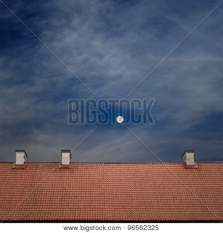 tiled top of the roof, cloudy blue sky