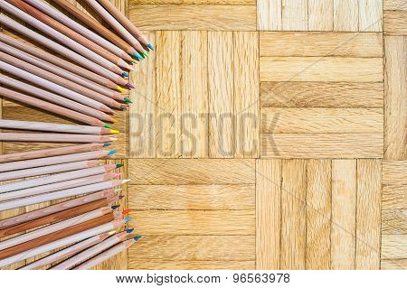 Ring Of Pencil With Wooden Body On Parquet Background