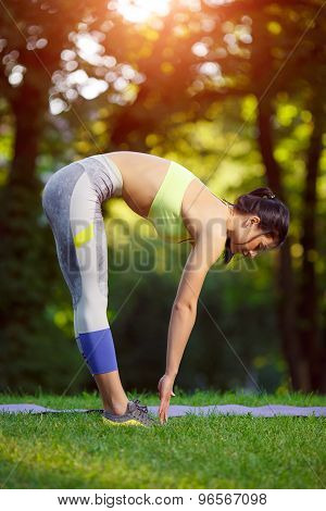 Woman doing fitness exercises in the park