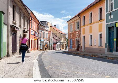 Kladno city, Czech Republic. July - 2012. Girl Walking by empty streets in small town Kladno