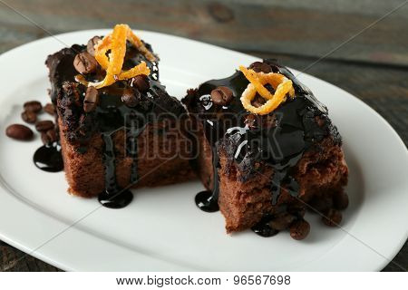 Portion of Cake with Chocolate Glaze and orange on plate, close-up