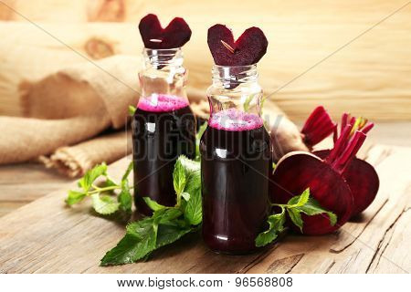 Fresh beet juice on wooden table, closeup