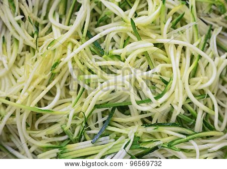 Grated zucchini and squash in pan close up