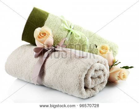 Rolled up colorful towels isolated on white