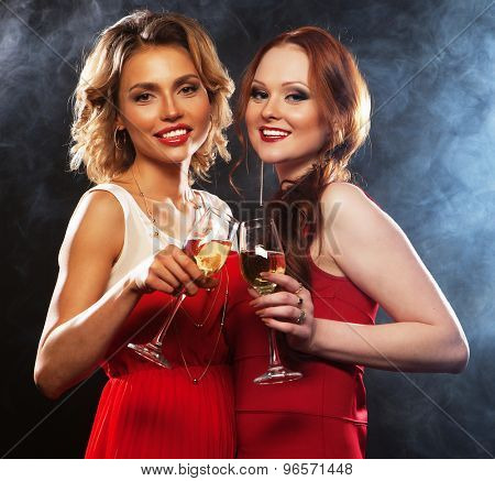 two beautiful young women with wine glasses and disco ball.