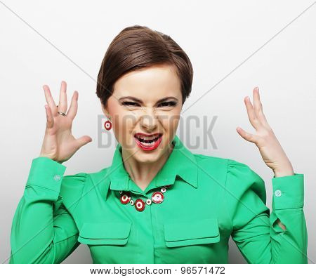 Screaming woman in green dress
