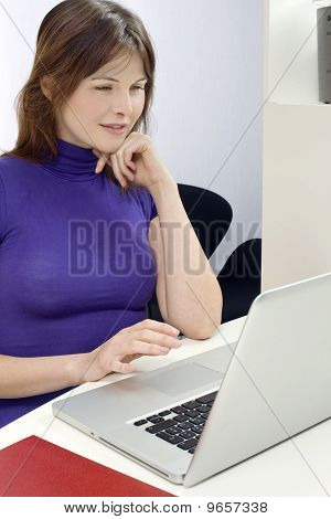 woman in office with laptop