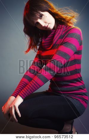 Pretty woman posing on gray background
