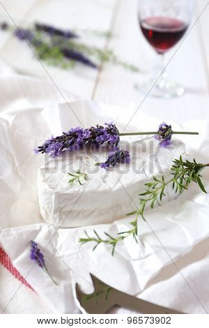 Lavender Sprig On Cow's Milk Cheese And Wineglass